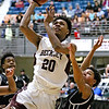 (Brad Davis/The Register-Herald) Woodrow Wilson's Mikey Penn drives and scores as Bluefield's Derrick Blevins defends during the Little General Battle for the Armory Tournament Thursday night at the Beckley-Raleigh County Convention Center.