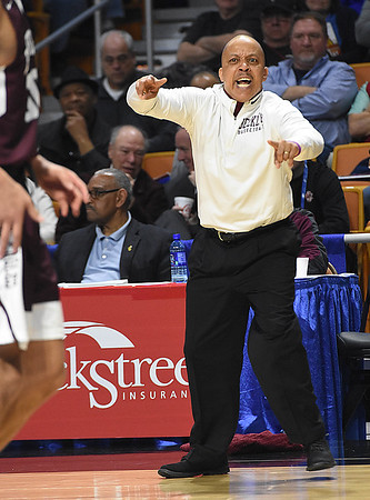 Woodrow Wilson head coach Ron Kidd working the sideline during game against Martinsburg in the quarter-final game of the Class AAA Boys State Basketball Tournament held at the Charleston Civic Center. Martingburg won 58-48<br /> (Rick Barbero/The Register-Herald)