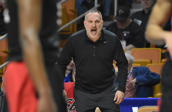 Greater Beckley Christian head coach Brian Helton, yells out from the bench against Tug Valley during the quarter-final game of the Class A Boys State Basketball Tournament held at the Charleston Civic Center. Tug Valley won 83-52<br /> (Rick Barbero/The Register-Herald)