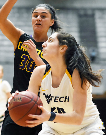 WVU Tech's Laura Requena (50) goes up for a shot over Carlow's Emma Stille (30) during the third quarter of their basketball game in Beckley Tuesday. (Chris Jackson/The Register-Herald)