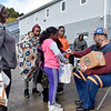 (Brad Davis/The Register-Herald) Miners mascot Big Paul hands out candy to hundreds attending their Trunk or Treat event Sunday afternoon at Linda K. Epling Stadium.