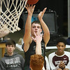 (Brad Davis/The Register-Herald) Wyoming East's Jacob Bishop shoots from three-point range and Woodrow Wilson's Ben Gilliam defends during the Little General Battle for the Armory Tournament Friday night at Beckley-Raleigh County Convention Center.