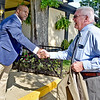 (Brad Davis/The Register-Herald) Beckley mayor Rob Rappold, right, and realtor Brian Brown, the driving voice behind an effort by city residents to change the name of Black Knight, formally greet one another at the facility for a brief meeting shortly after Rappold and other city officials decided they would do so Thursday evening.