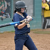 (Brad Davis/The Register-Herald) Greenbrier West's Camryn Dorsey takes a cut during the Cavaliers' rain-soaked thriller at Fayetteville Wednesday night.