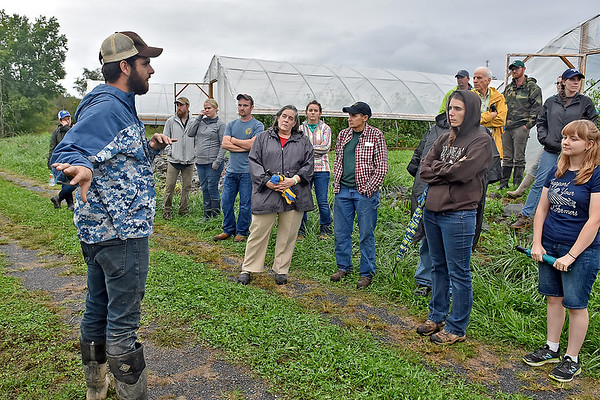 (Brad Davis/The Register-Herald) Sprouting Farms production manager Lucas Hilsbos, left, shows a group of visitors an array of high tunnels, the primary method of farming being used and developed on the grounds of Sprouting Farms during a WV CRAFT (Collaborative Regional Alliance for Farmer Training) open house style event Sunday afternoon in Talcott.