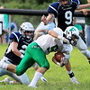 Fayetteville's Jordan Dempsey (9) is tackled into the end zone for a touchdown by Valley's Austin Hess (2) and Adam Falbo (9) during the first quarter of their high school football game Friday in Smithers. (Chris Jackson/The Register-Herald)