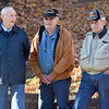 "(Brad Davis/The Register-Herald) Mt. Hope city councilman Charles Kidd, left, shares a laugh with Air Force veteran Jim ""Sarge"" Helton, middle, and Army veteran Frank Tucker as they take in the town's annual Veteran's Day ceremony in front of the War Memorial on Main Street Sunday afternoon."