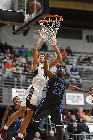 Woodrow's Eddie Christian's scores over a Capital player during the second quarter of their basketball sectional championship against Capital Tuesday in Beckley. (Chris Jackson/The Register-Herald)