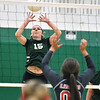 (Brad Davis/The Register-Herald) Fayetteville's Abby Garvin returns a ball as Liberty's Kayla Honaker plays close to the net August 29 in Fayetteville.