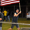 (Brad Davis/The Register-Herald) A stars and stripes-clad Indy student goes for a run as he celebrates a Patriots score Thursday night in Shady Spring.