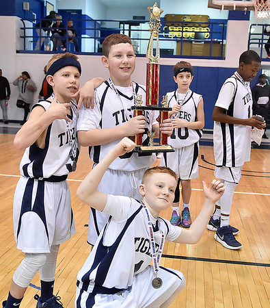 (Brad Davis/The Register-Herald) Shady Elite players strike poses for family snapping photos after defeating the Tri State Assault (Huntington) for the sixth grade Biddy Buddy Championship Sunday afternoon inside WVU Tech's Van Meter Gym.