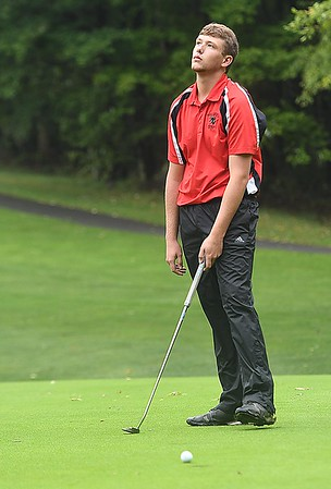 Carson Profit, of Pikeview, reacts after leaving a putt just short during the Class AA Region 3 golf tournament held at Grandview Country Club in Beaver.<br /> (Rick Barbero/The Register-Herald)