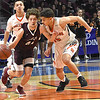 Danny Bickey, of Woodrow Wilson,  left, brings the ball up court aaginst, Teddy Marshall, of Martinsburg during the quarter-final game of the Class AAA Boys State Basketball Tournament held at the Charleston Civic Center. Martingburg won 58-48<br /> (Rick Barbero/The Register-Herald)