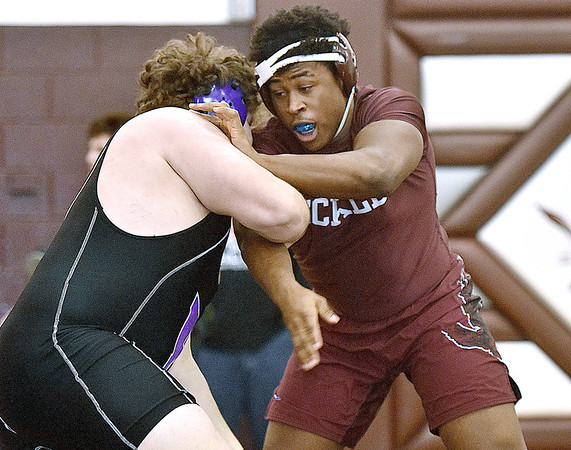 (Brad Davis/The Register-Herald) Woodrow Wilson's Tyree Swafford takes on Riverside's Austin Chapman in a heavyweight class matchup during the Class AAA Regionals Saturady afternoon at Woodrow Wilson High School. Riverside's Chapman won the match.