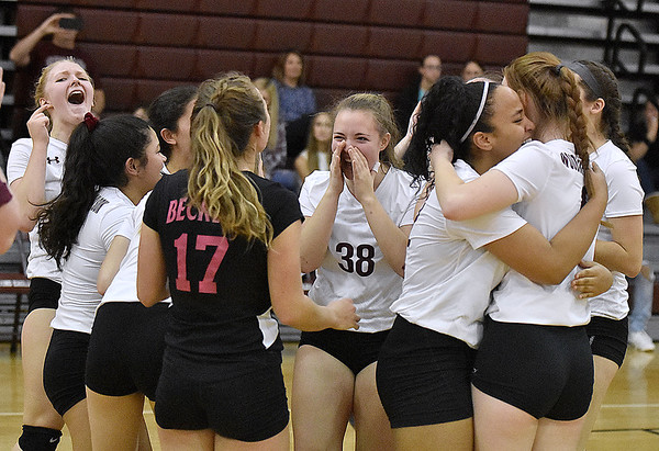 (Brad Davis/The Register-Herald) Woodrow Wilson players celebrate after defeating George Washington during the Class AAA Regional Volleyball tournament Saturday afternoon, punching their ticket to next week's State Tournament in Charleston.