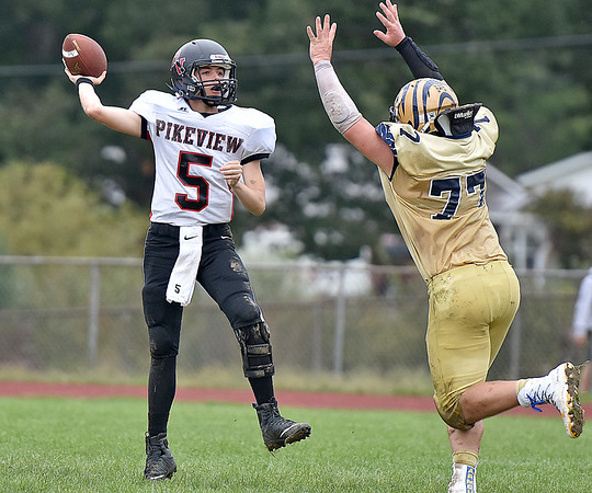 (Brad Davis/The Register-Herald) PikeView quarterback Jerrett Ellison tries to throw over converging Shady Spring lineman Terymykal Alexander Saturday afternoon in Shady Spring.