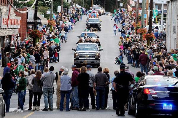 Hundred of people gather to watch the last Fayetteville High School Homecoming Parade in Fayetteville on Friday. (Chris Jackson/The Register-Herald)