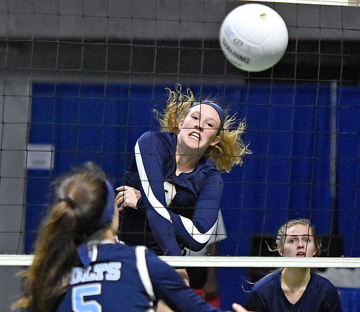 (Brad Davis/The Register-Herald) Shady Spring's Olivia Barnett spikes the ball past Philip Barbour's Alyssa Hill during State Volleyball Tournament action Friday evening at the Charleston Civic Center.
