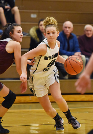 Wyoming East's Skylar Davidson drives past Woodrow Wilson's (12) during their basketball game Wednesday in New Richmond. (Chris Jackson/The Register-Herald)