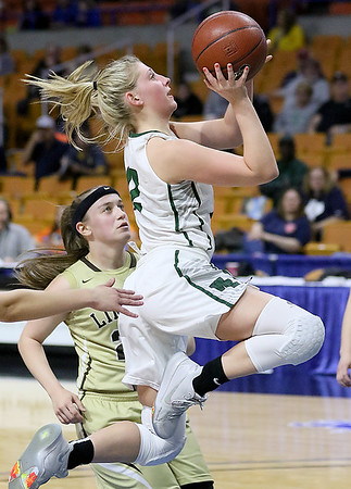 (Brad Davis/The Register-Herald) Wyoming East's Misa Quesenberry drives and scores as Lincoln's Gracey Lamm defends Wednesday afternoon at the Charleston Civic Center.