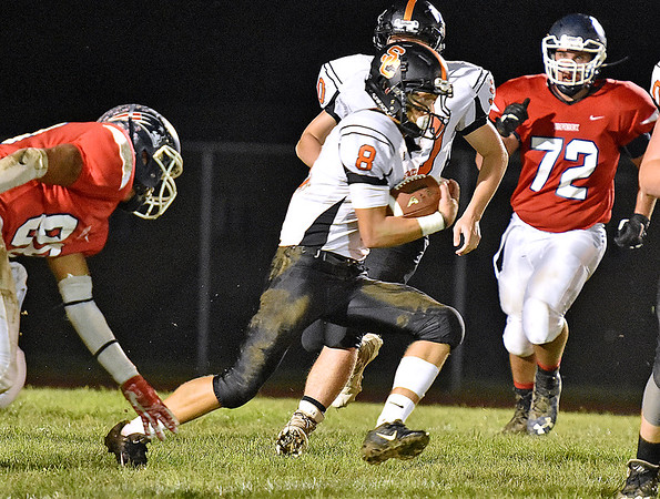 (Brad Davis/The Register-Herald) Summers County's Sam Wykle slices through the Independence defense for a long, 1st quarter touchdown run Friday night in Coal City.