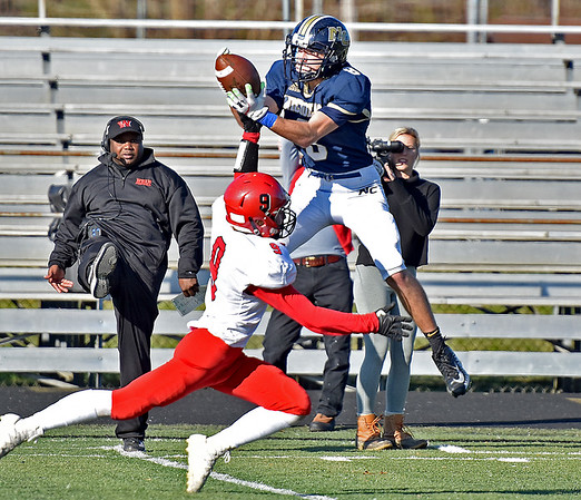 (Brad Davis/The Register-Herald) Nicholas County receiver Nick Kiser makes a highlight reel, deep ball catch over Weir defensive back Brodie McUmar Saturday afternoon in Summersville.