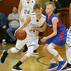 (Brad Davis/The Register-Herald) Fayetteville's Luke Vass moves along the perimeter along the perimeter as Midland Trail's Austin Isaacs defends Friday night at the Soldiers & Sailors Memorial Building.