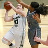 (Brad Davis/The Register-Herald) Wyoming East's Allie Lusk drives and scores as George Washington's Nevaeh Harman defends during Big Atlantic Classic action Saturday the Beckley-Raleigh County Convention Center.