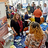 (Brad Davis/The Register-Herald) Job seekers link up with round 137 employers from local and national organizations during a Job and Resource Fair inside the Erma Byrd Higher Education Center Friday afternoon.
