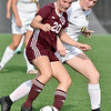 (Brad Davis/The Register-Herald) Woodrow Wilson's Logan Ragland battles for possession with Greenbrier East's Kate Perkins Friday evening at the YMCA Paul Cline Memorial Soccer Complex.