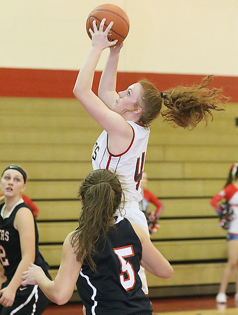 (Brad Davis/The Register-Herald) Independence's Lexi Bolen drives and scores as PikeView's Olivia Boggess (#5) defends Thursday night in Coal City.