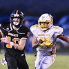 Summers County's Timmy Persiani (10) is chased down and tackled by Mont View's Kamal Collins (44) during their high school football game Thursday in Hinton. (Chris Jackson/The Register-Herald)