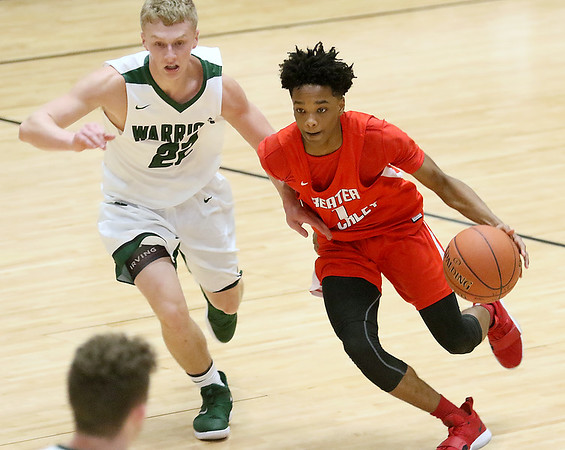 (Brad Davis/The Register-Herald) Greater Beckley Christian's Elijah Edwards hustles up the court under pressure by Wyoming East's McQuade Canada during the Little General Battle for the Armory consolation game Saturday night at Beckley-Raleigh County Convention Center.