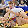 (Brad Davis/The Register-Herald) Independence's Sean Dawson takes on East Fairmont's Cole Laya for the Class A/AA 120-pound weight class championship during State Wrestling Tournament action Saturday night at the Big Sandy Arena. Indy's Gibson won the match.