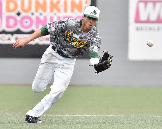 (Brad Davis/The Register-Herald) Miners 2nd baseman Fernando Ortiz makes a running play on a slow chopper off the bat of Champion City hitter Gregory Lewandoski during the first game of a double header against Champion City Wednesday at Linda K. Epling Stadium.