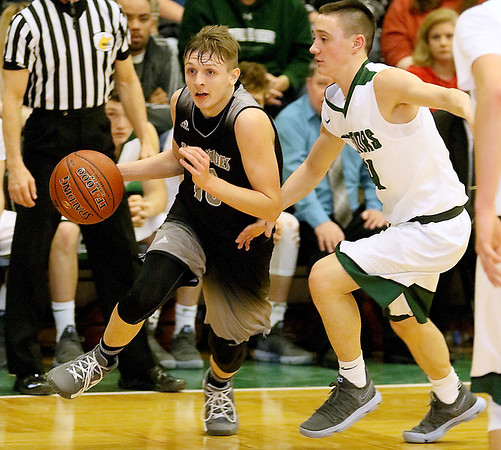(Brad Davis/The Register-Herald) Westside's Isaiah Lester speeds past Wyoming East defender Caden Lookabill Saturday night in New Richmond.
