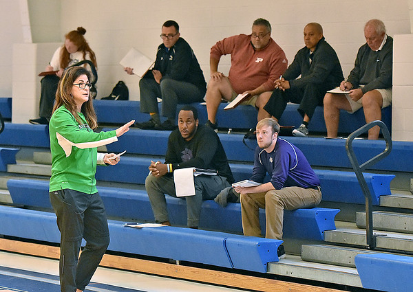 """(Brad Davis/The Register-Herald) Attending coaches from area high schools and colleges pay attention and take notes as Stetson University women's basketball head coach Lynn Bria describes the """"Princeton Offense"""" system during this year's WVU Tech Coaches clinic Sunday morning in the Van Meter Gymnasium."""