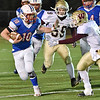 (Brad Davis/The Register-Herald) Midland Trail's Morgan Ferris braces for a hit from Williamstown's Mason Deem as he gains yards on a carry Friday night in Fairlea.