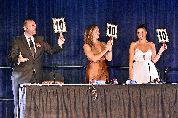 "(Brad Davis/The Register-Herald) Judges Matt Barber, Amanda Barber and Gabrielle Colombo score ""10's"" during the United Way of Southern West Virginia's Dancing With the Stars fundraising event Friday night at the Beckley-Raleigh County Convention Center."