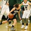 (Brad Davis/The Register-Herald) Westside's Carla Cook looks for a lane along the perimeter as Wyoming East's Jazz Blankenship defends Thursday night in New Richmond.