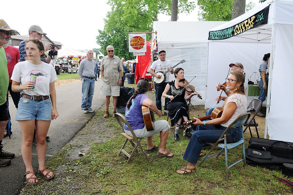 A group of musicians jam during the 2018 Appalachian String Band Festival in Clifftop on Wednesday. (Chris Jackson/The Register-Herald)