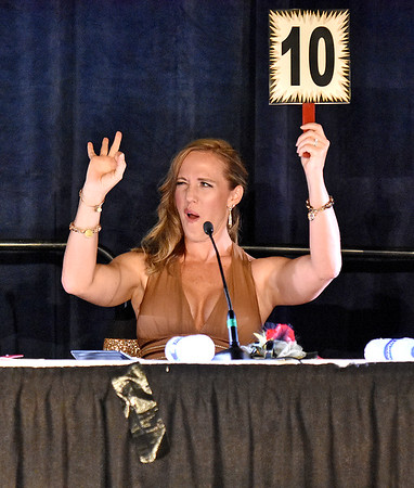 "(Brad Davis/The Register-Herald) Judge Amanda Barber scores a ""10"" during the United Way of Southern West Virginia's Dancing With the Stars fundraising event Friday night at the Beckley-Raleigh County Convention Center."
