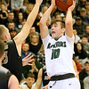 (Brad Davis/The Register-Herald) Wyoming East's Chase York drives as Westside's Jacob Ellis defends Saturday night in New Richmond.