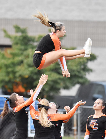 Summers County cheerleaders warm-up prior to kickoff of their high school football game against Shady Spring Friday in Hinton. (Chris Jackson/The Register-Herald)