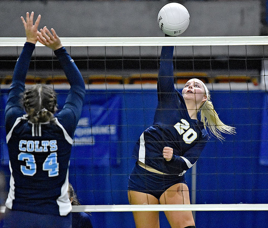 (Brad Davis/The Register-Herald) Shady Spring's Bradlea Hayhurst spikes the ball as Philip Barbour's Emma Kennedy defends during State Volleyball Tournament action Friday evening at the Charleston Civic Center.