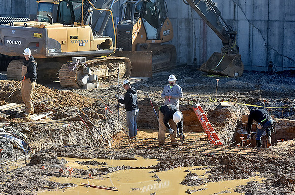 (Brad Davis/The Register-Herald) Construction workers with PCM Contracting Services out of Sophia continue work on the new Beckley Police station Thursday afternoon at its soon-to-be Neville Street location.