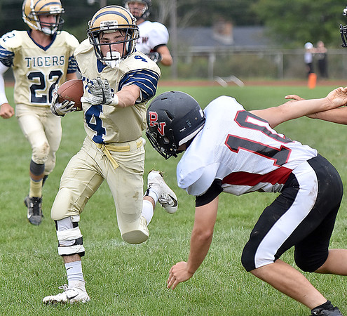 (Brad Davis/The Register-Herald) Shady Spring's Justin Black extends a stiff arm to ward off incoming Panthers defender Ethan Begovich during the Tigers' homecoming win over visiting PikeView Saturday afternoon.