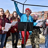 "(Brad Davis/The Register-Herald) Concerned citizen and activist DL Hamilton, middle, enthusiastically leads the crowd in song during the ""It's Our Time"" rally marking the one-year anniversary of the Women's March Saturday morning in Beckley's Showmaker Square."