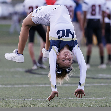 A Nicholas County Cheerleader warms up with a back handspring before the game. Chad Foreman for the Register-Herald.
