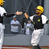 (Brad Davis/The Register-Herald) Miners baserunner DePaul Blunt is greeted by teammate Cole Coffey after the two scored off a bases-loaded single by teammate Maddux Houghton during the 6th inning against Lafayette Friday night at Linda K. Epling Stadium.